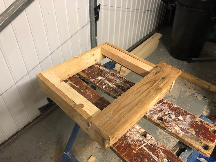 Nail your boards to the base of the dog bowl stand