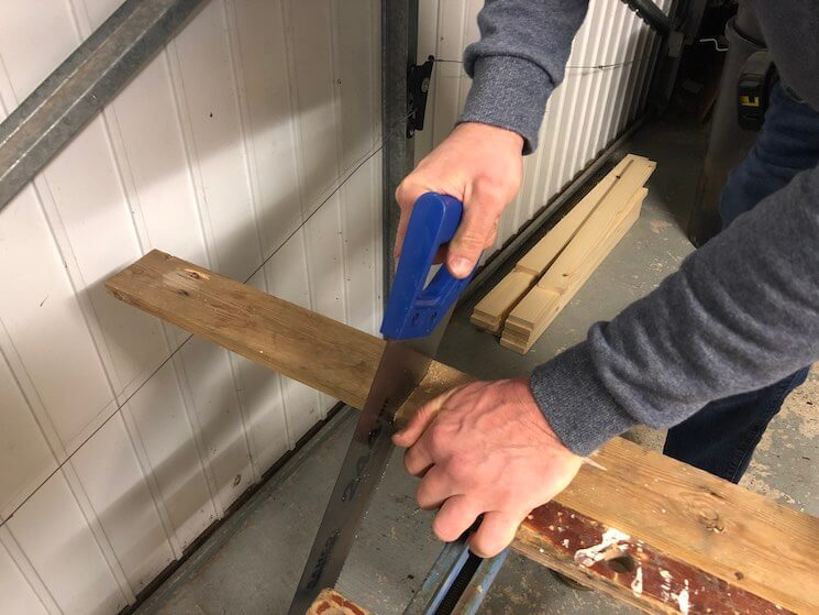 Cut both width pieces using a handsaw